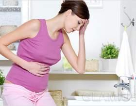 Чому болить живіт при вагітності фото